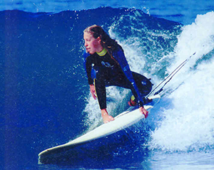Paradise Surf Shop owner Sara Bray Zimmerman surfing in Santa Cruz