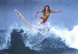 Sara Bray Zimmerman surfing, photo by Jim pidgeon