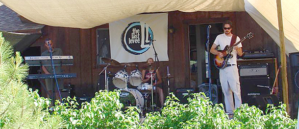 Our Band, The Last Levee, playing outside